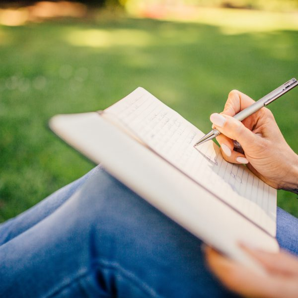 making notes in a journal