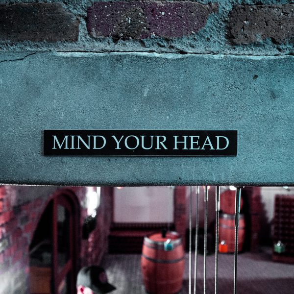 A sign saying 'mind your head'