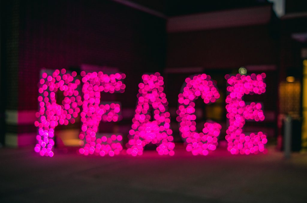 the word peace in lights